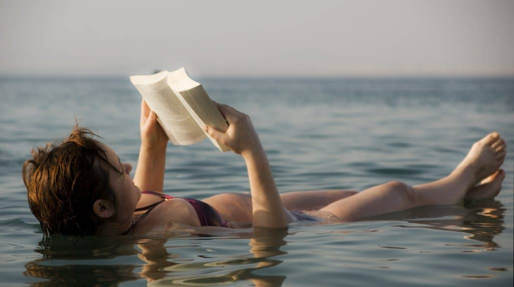 The Dead Sea   woman reading a book